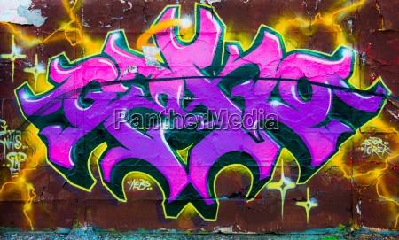 concrete letters purple daub graffiti grafitti