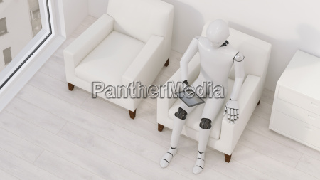 robot sitting on armchair with tablet