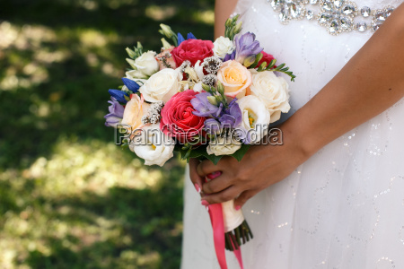 multicolor bouquet in hands of the