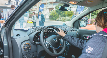 woman watching a car on the
