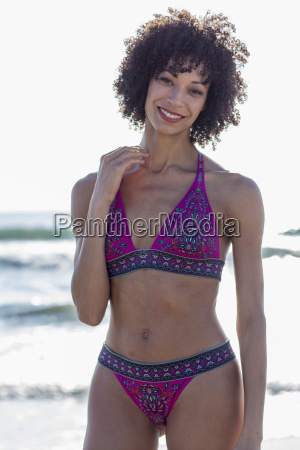 mixed race woman wearing bikini near